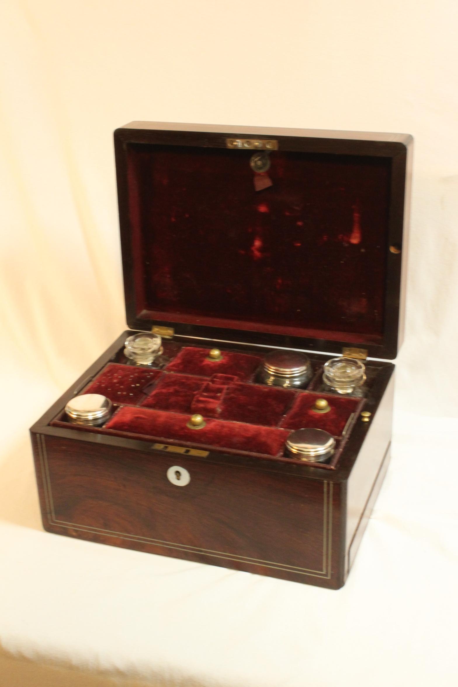 Rosewood veneered ladies travelling box with secret drawer Secret drawer
